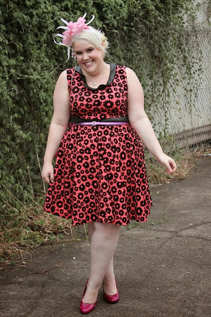 adorable plus size outfit with pink and black flower dress and pink fascinator