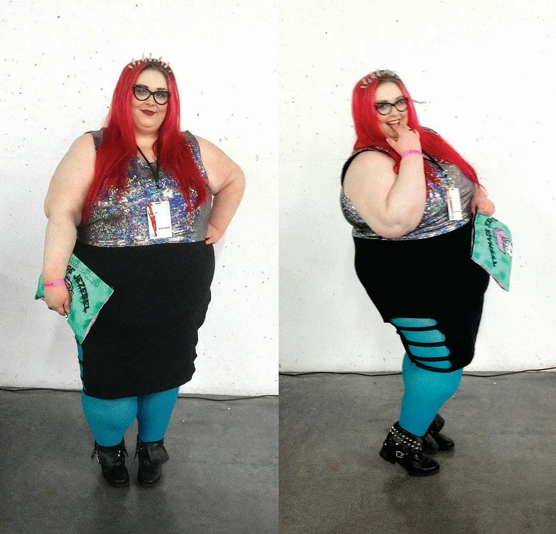 woman wearing holographic top, black skirt, aqua blue leggings, and crystal crown
