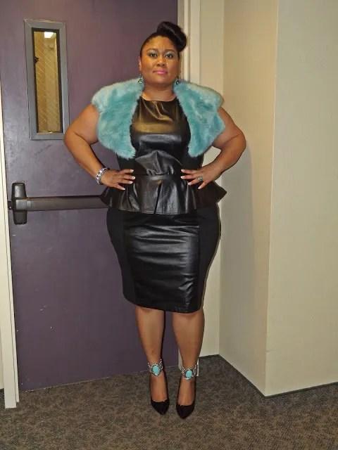 plus size woman wearing leather peplum dress and blue fake fur shrug