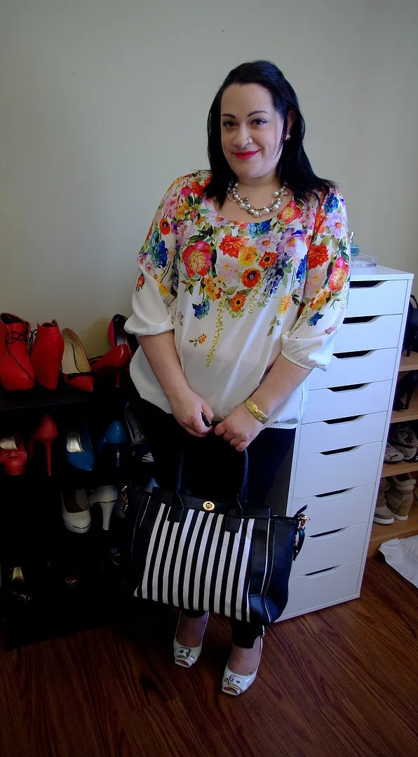 plus size outfit with white floral top and black pants