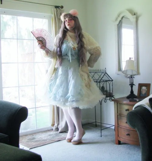 plus size cult party kei outfit with white petticoat, blue dress, and pink hair poofs