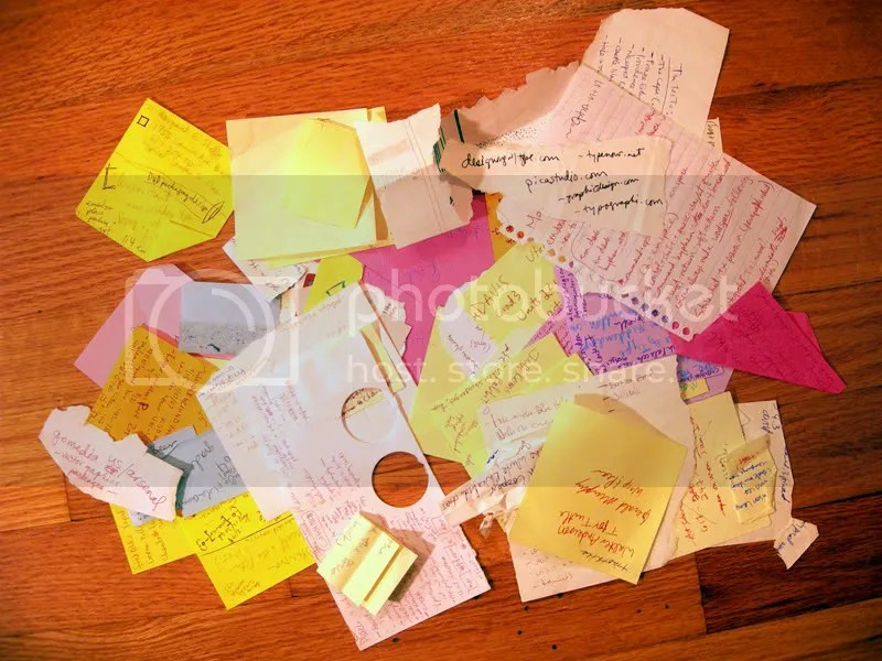 Lots of sticky notes and things written on little pieces of paper.