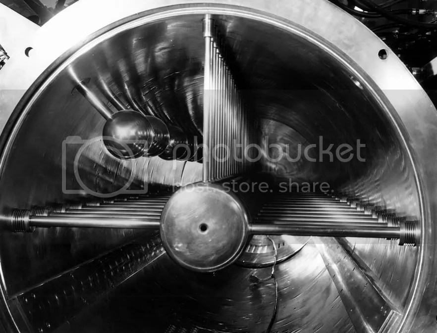 A view down the  Zero Gradient Synchrotron's 110-foot linear accelerator. (Archival Photographic Files, apf digital item number apf2-00487, Special Collections Research Center, University of Chicago Library)