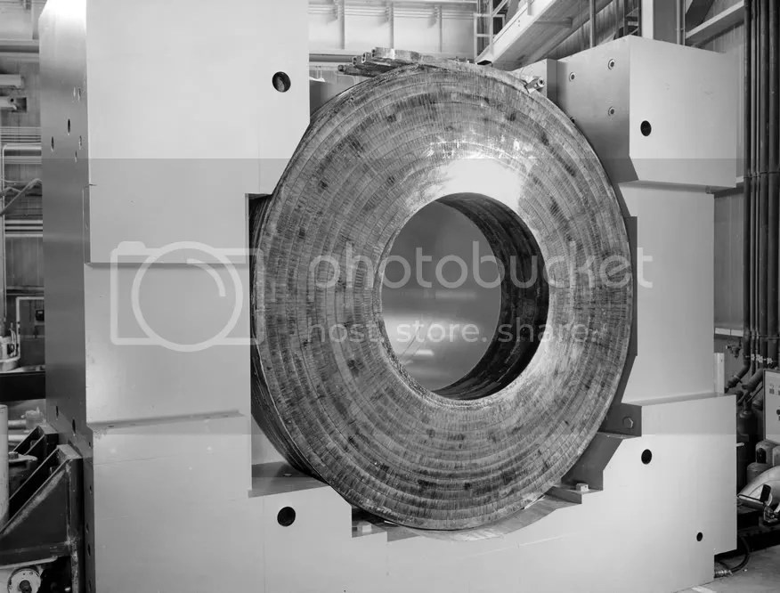 The enormous coil and magnet yoke that would encase a 30-inch hydrogen bubble chamber. (Archival Photographic Files, apf digital item number apf2-00491, Special Collections Research Center, University of Chicago Library)