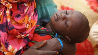 Kenya - A child sleeps at the Ifo refugee camp