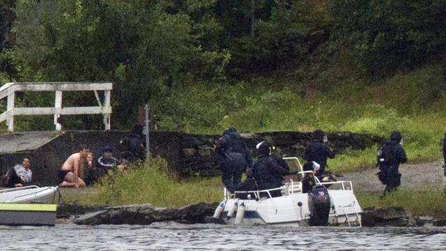 A Norwegian swat team lands on Utoeya as terrified young people cower nearby