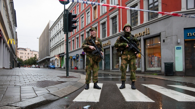Aftermath - Military stands guard near the site of Friday's bomb