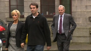 Seán Quinn Jnr leaves court with his wife and his father