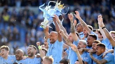 Vincent Kompany raises the Premier League trophy