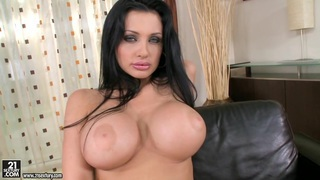 Aletta Ocean huge titty babe dildoing on couch porn image