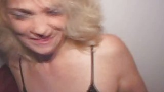 Mature Blonde On Her Knees Sucking Dick At Glory Hole porn image