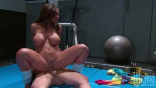 Trashy slut Lisa Ann rides the cock in a gym and gets thrusted from behind porn image