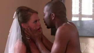 Cheating bride Tori Black blows dick of black man and gives her pussy porn image