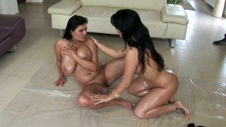 Two hottest chicks in the porn industry Jasmine Black and Amanda Black are rubbing each other's bodies with oil porn image