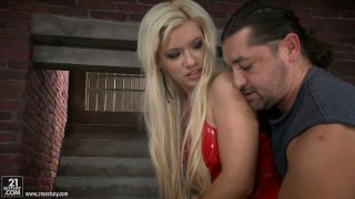 Bibi Noel in outrageous dress is on her knees giving_blowjob porn image