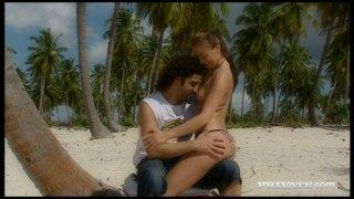 Seductive_hooker_Gilda_Roberts_gets_cunnilingus_on_the_beach porn image