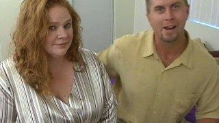 Red head mom Red Roze gets her huge boobs squeezed and suckled porn image