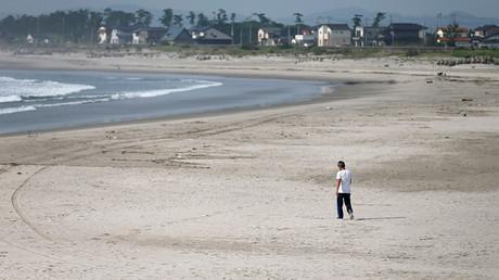 A man walks at the empty Yotsukura municipal beach in Iwaki, about 40 km (25 miles) south of the tsunami-crippled Fukushima Daiichi nuclear power plant, Fukushima © Issei Kato