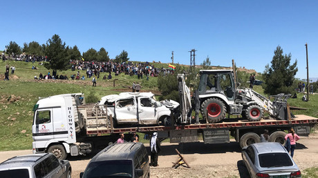 Damaged vehicles that belonged to Kurdish fighters from the People's Protection Units (YPG) are transported from their headquarters after it was hit by Turkish airstrikes in Mount Karachok near Malikiya, Syria April 25, 2017. © Rodi Said