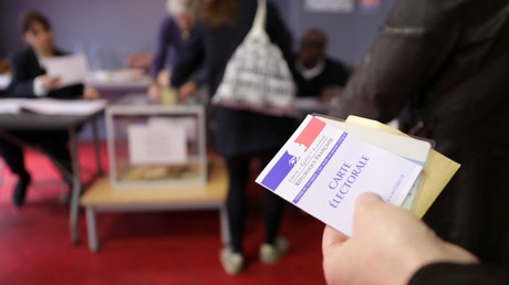 A person holds a voter's registration card, Paris, France, May 7, 2017. © Eric Gaillard