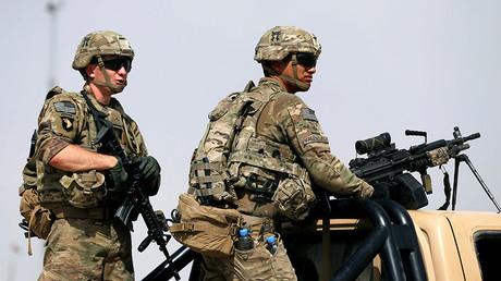 U.S. troops keep watch on the back of a truck outside their base in Uruzgan province, Afghanistan July 7, 2017 © Omar Sobhani
