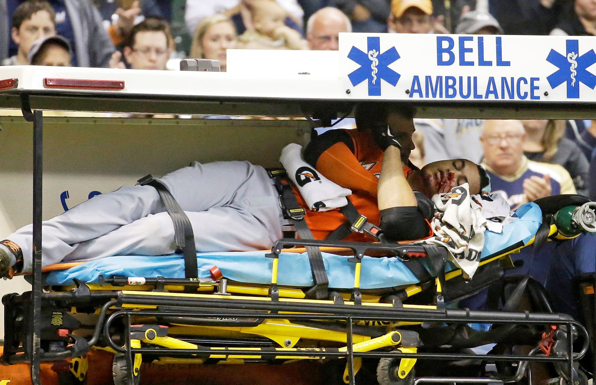 Miami Marlins' Giancarlo Stanton is taken off the field on a stretcher after being hit in the face with a pitch during the fifth inning against the Milwaukee Brewers Sept. 11 in Milwaukee.