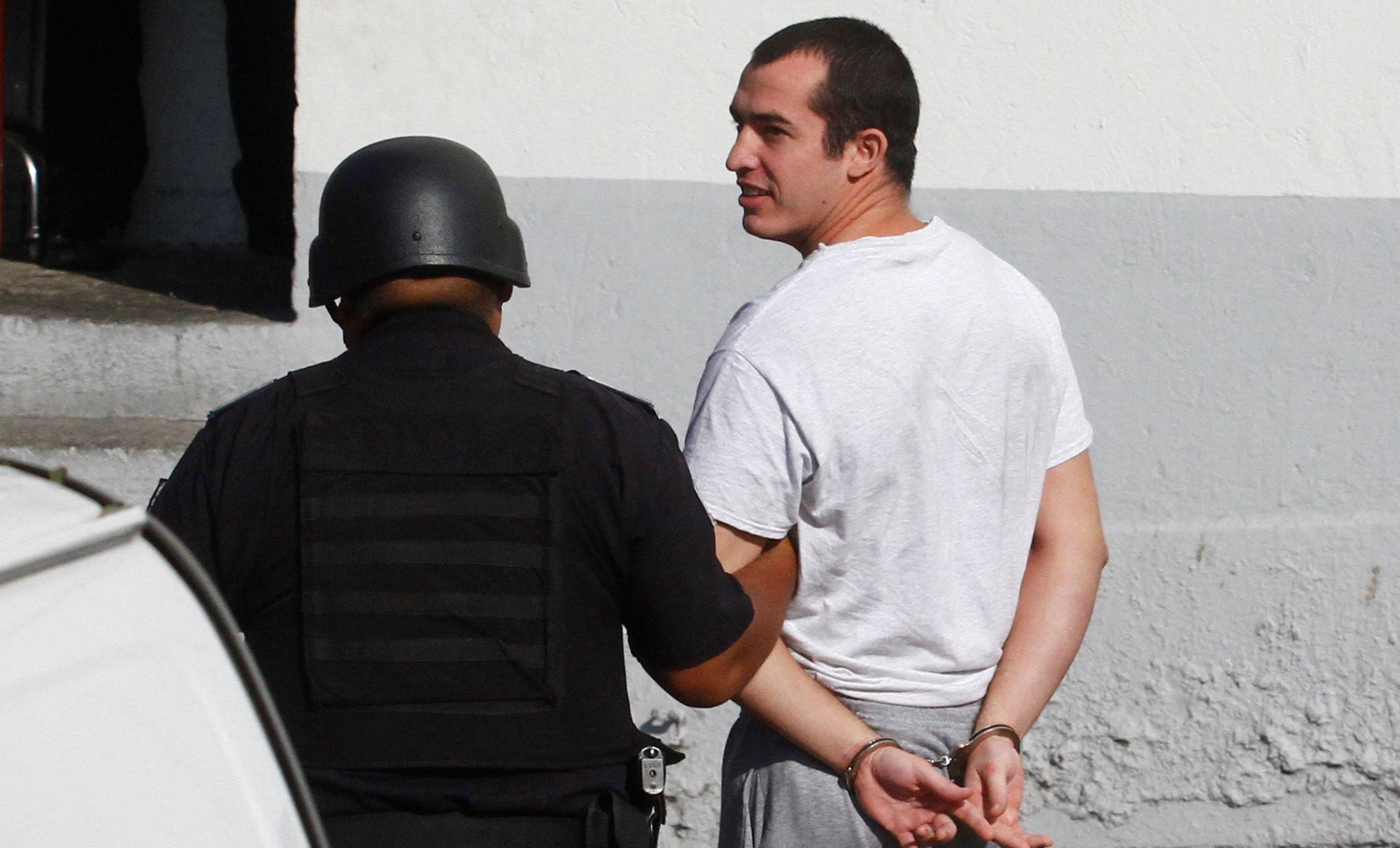 Former U.S. Marine Andrew Tahmooressi  is escorted to a federal court in Tijuana August