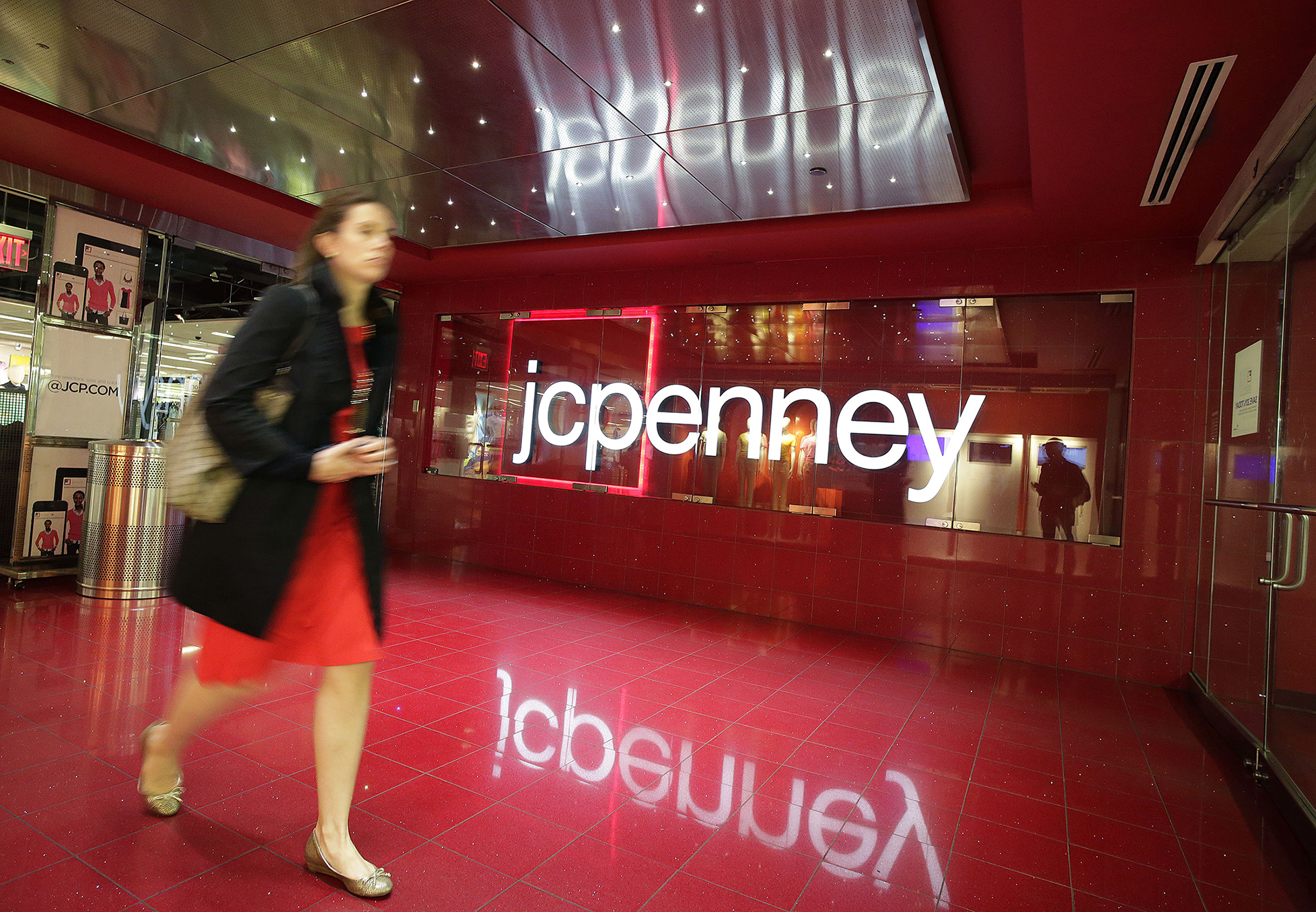 A customer leaves a JC Penney store in New York.