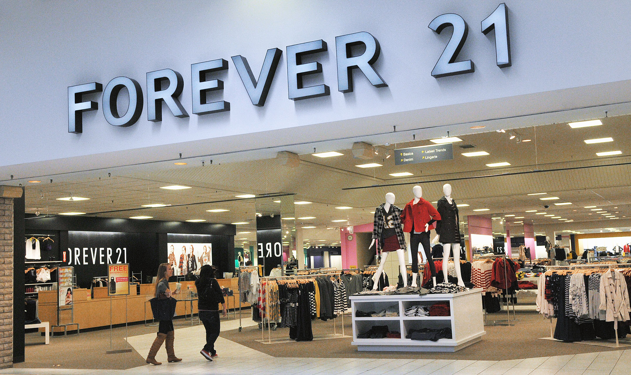 Shoppers walk into a Forever 21 store.