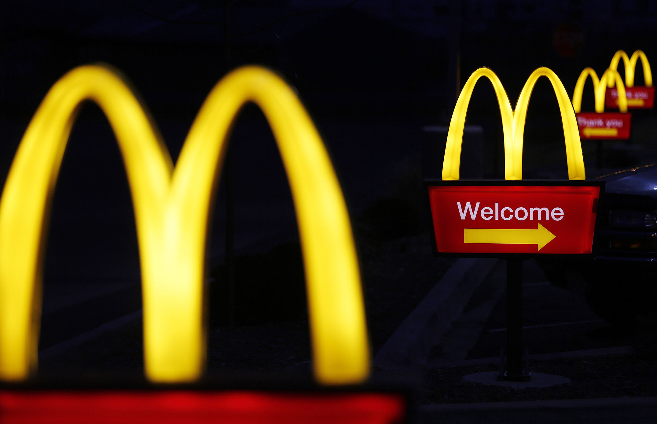 Illuminated golden arches mark the entrance to a McDonald's restaurant in Shelbyville, Ky.