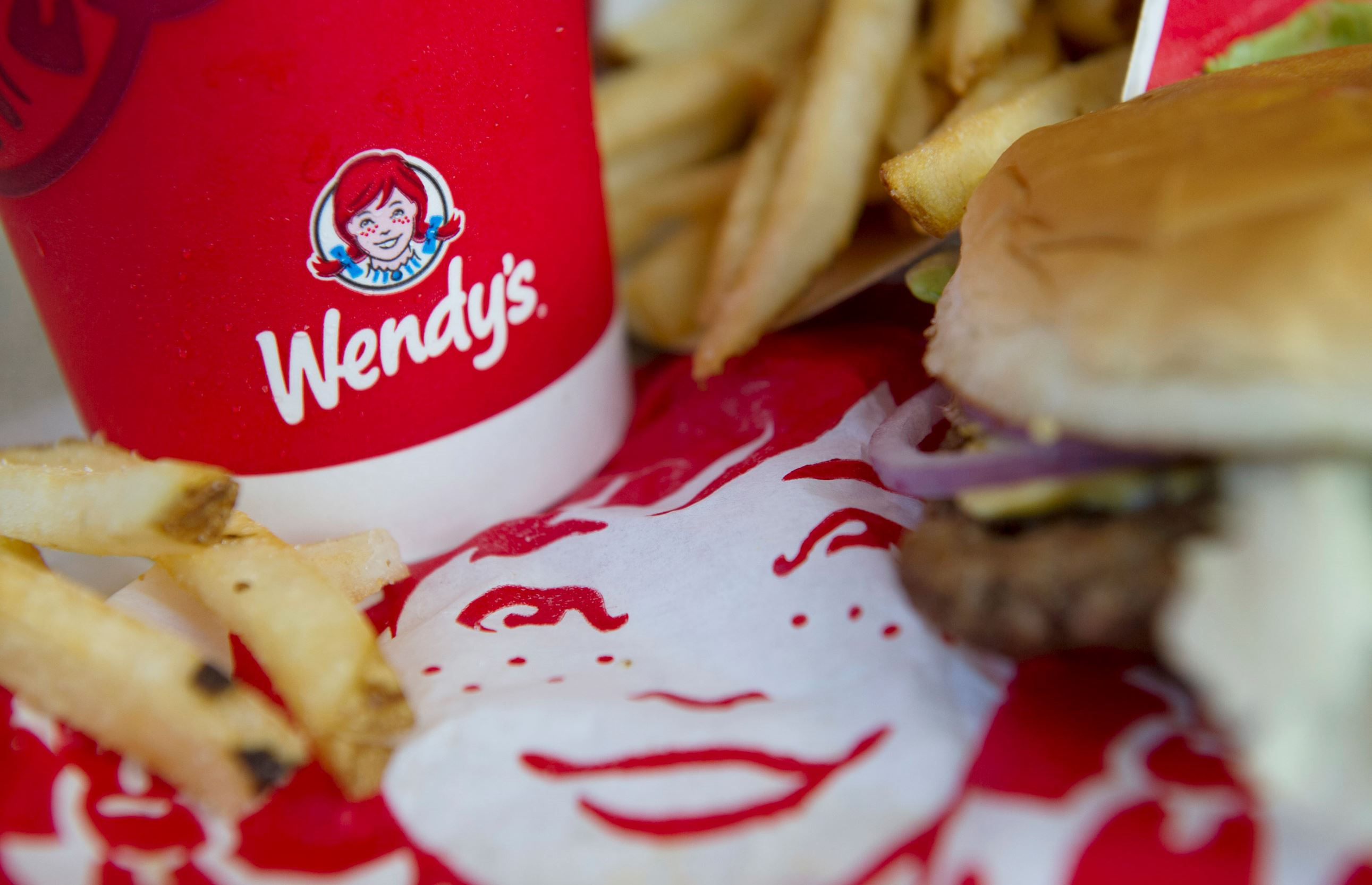 The Wendy's Co. logo is seen on a cup at a Wendy's in Daly City, Calif.