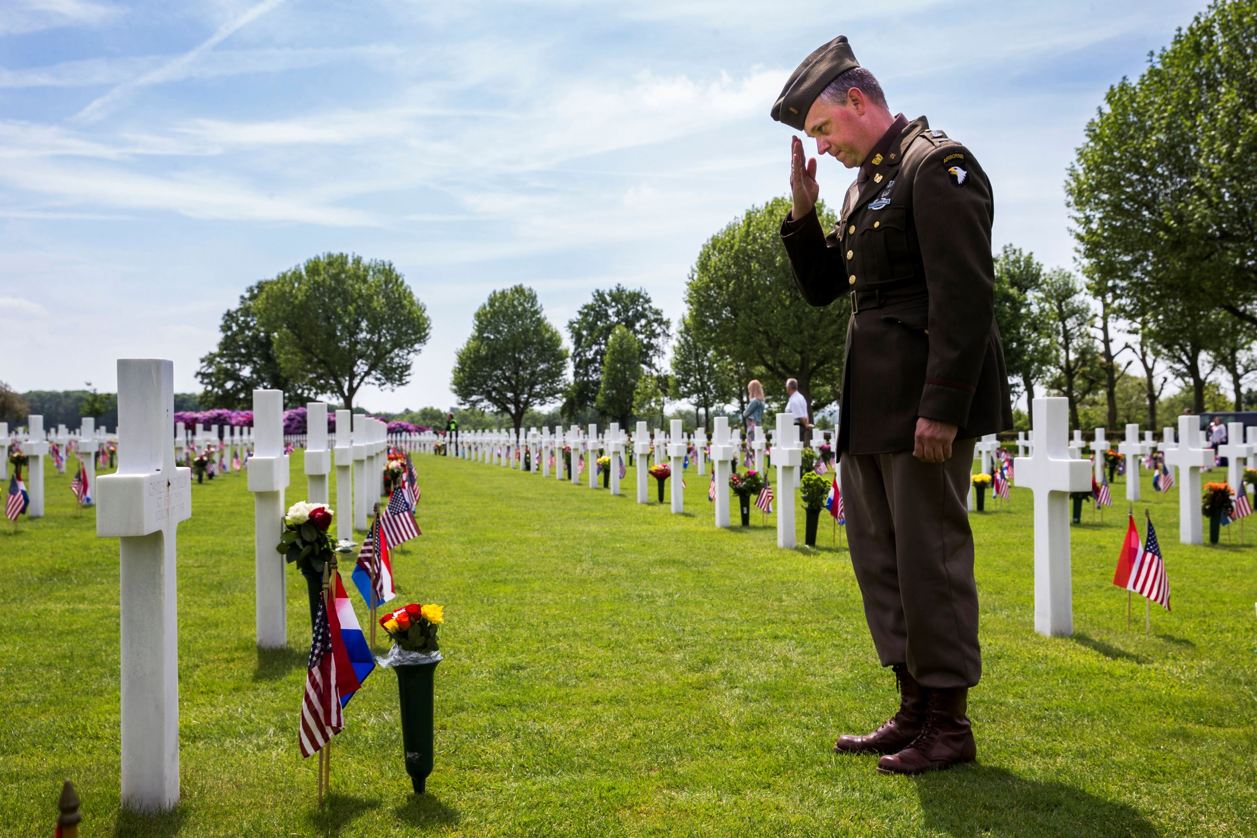 © Vincent Jannink/AP Photo Dutch Eric Ommering, wearing a WWII uniform, salutes at a grave he adopted of Sergeant Charles Mc Millan, 315 Infantry 79 Division, from Michigan, during a Memorial Day commemoration