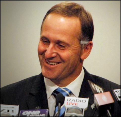 john key, press conference, mask