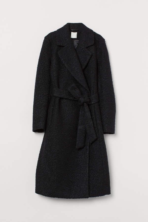Coat with a tie belt