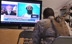 US Marine watches TV announcing the death of Osama Bin Laden.