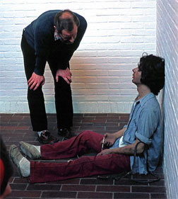 Duane Hanson's 1974 sculpture Drug Addict, observed by a museum guest