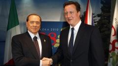 Le premier ministre britannique, David Cameron (à droite), et son homologue italien, Silvio Berlusconi, à Huntsville, le 25 juin.