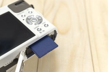 insert or remove memory card from camera.