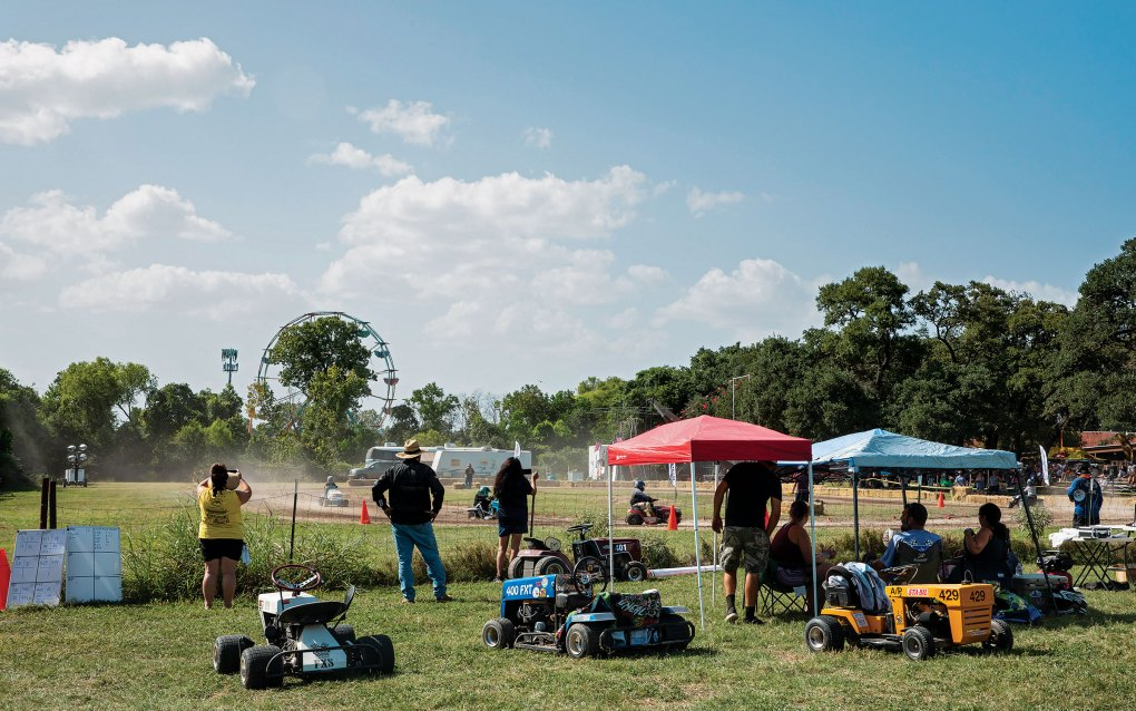 Competitors watch from the sidelines at the Lone Star Mower Racing Association lawn mower races at the Kendall County Fairgrounds in Boerne, on September 4, 2021.
