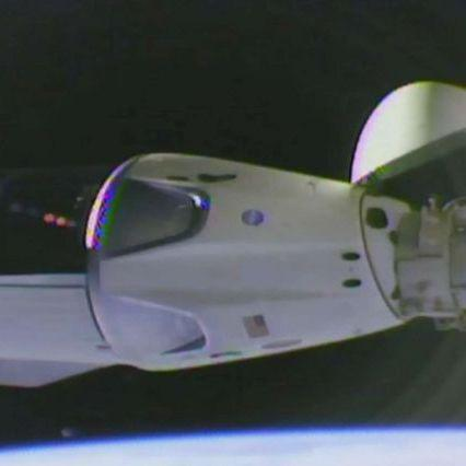 Space, SpaceX's Dragon Crew capsule docks at the ISS station