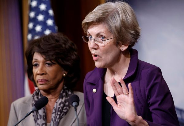 Sen. Elizabeth Warren (R) (D-Mass.), a member of the Senate Banking Committee, and Rep. Maxine Waters (D-Calif.), ranking member of the House Financial Services Committee, express their outrage to reporters that a huge, $1.1 trillion spending bill approved by the Republican-controlled House yesterday contains changes to the 2010 Dodd-Frank law that regulates complex financial instruments known as derivatives, Wednesday, Dec. 10, 2014, on Capitol Hill in Washington. Democratic support for the omnibus bill funding every corner of government faded Wednesday as liberal lawmakers erupted over a provision that weakens the regulation of risky financial instruments and another that allows more money to flood into political parties. (AP Photo/J. Scott Applewhite)