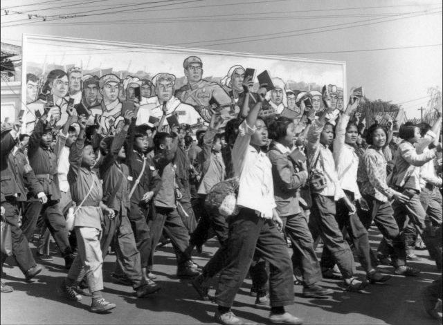 """Chinese Red Guards, high school and university students, waving copies of Chairman Mao Zedong's """"Little Red Book,"""" parade in Beijing's streets at the beginning of the Cultural Revolution on June 1966. During China's Cultural Revolution (1966-1976), under the command of Mao, Red Guards rampaged through much of the country, humiliating, torturing, and killing perceived class enemies, and pillaging cultural symbols that were deemed as not representative of the communist revolution. (Jean Vincent/AFP/Getty Images)"""