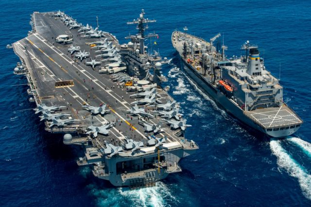 The aircraft carrier USS Carl Vinson (CVN 70) conducts a replenishment-at-sea with the fleet replenishment oiler USNS Yukon (T-AO 202) in the Pacific Ocean on July 26, 2016. (U.S. Navy Mass Communication Specialist 2nd Class Patrick W. Menah Jr./U.S. Navy)