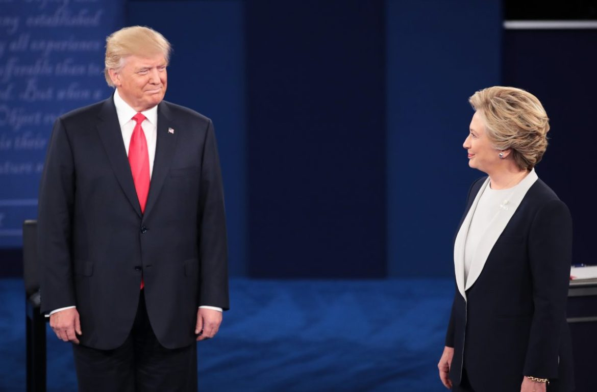 Republican presidential nominee Donald Trump (L) and Democratic presidential nominee Hillary Clinton during the town hall debate at Washington University in St. Louis, Missouri, on Oct. 9, 2016. (Scott Olson/Getty Images)