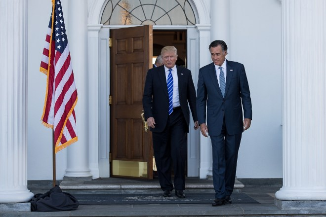 President-elect Donald Trump and Mitt Romney leave the clubhouse after their meeting at Trump International Golf Club in Bedminster Township