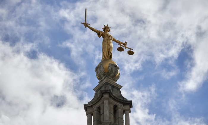 """The """"Lady of Justice"""", a 12 foot high, gold leaf statue is pictured on top of the dome of the Central Criminal Court, commonly referred to as The Old Bailey in central London, on Aug. 21, 2016. (Niklas Halle'n/AFP/Getty Images)"""