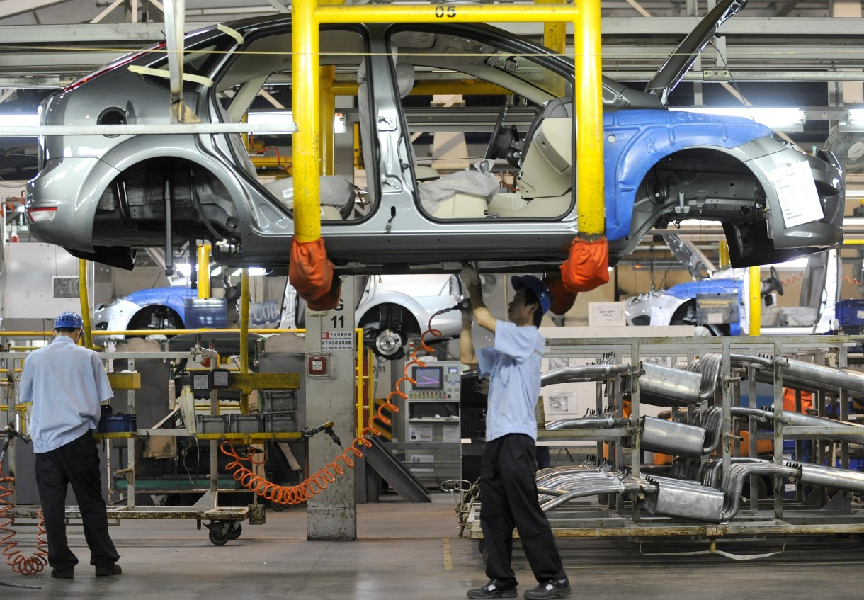 Workers on a vehicle assembly line at the Ford-Chang'an joint venture plant in Chongqing, China, on June 3, 2011. (LIU JIN/AFP/Getty Images)