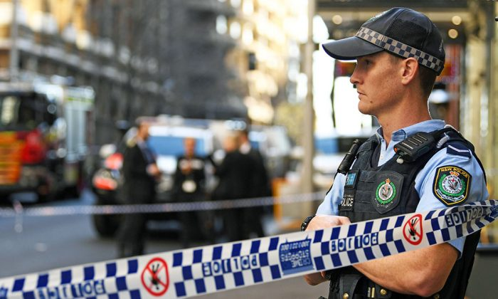 A New South Wales Police officer at a crime scene  in Sydney, Australia, on Aug. 13, 2019. (Saeed Khan/AFP/Getty Images)