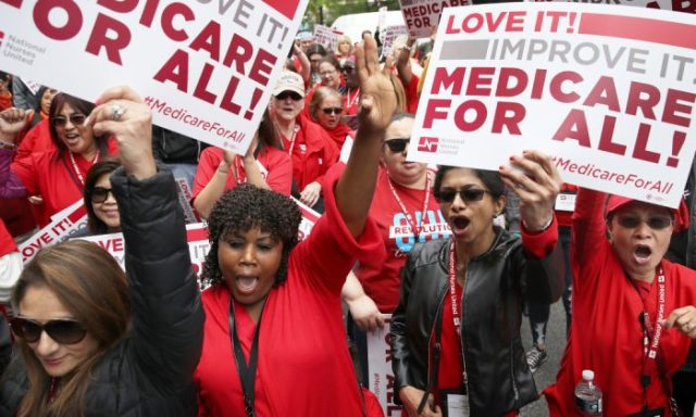 "Protesters supporting ""Medicare for All"" hold a rally outside PhRMA headquarters in Washington, DC. on April 29, 2019. (Win McNamee/Getty Images)"