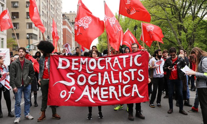 Members of the Democratic Socialists of America gather outside of a Trump owned building on May Day in New York City, on May 1, 2019. (Spencer Platt/Getty Images)